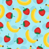 Seamless pattern with yellow bananas and red strawberries. Cute vector background. Fruits illustration on blue. Background Royalty Free Stock Photos