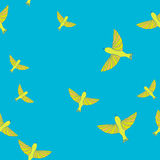 Seamless pattern with yellow birds on blue background Royalty Free Stock Photography