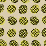 Seamless pattern with yellow and black ovals speckled Stock Photos