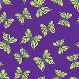 Seamless pattern with yellow butterflies on the purple background Stock Images