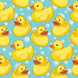 Seamless pattern with yellow ducks. Royalty Free Stock Photo
