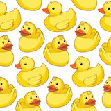 Seamless pattern with yellow ducks. Royalty Free Stock Image