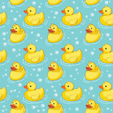 Seamless pattern with yellow ducks. Royalty Free Stock Images