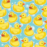 Seamless pattern with yellow ducks. Stock Photos