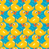Seamless Pattern with yellow ducks, childish background Stock Images