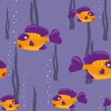 Seamless pattern yellow fish. Funny yellow fish swims in the sea Stock Photo