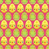 Seamless pattern of yellow and green tilted easter eggs. Seamless pattern of yellow and green eggs having a st Patrick style pattern on pink background Stock Photo