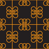 Seamless pattern of yellow intertwining ribbons on black background. Stock Photos