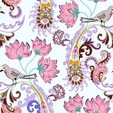 Seamless pattern with yellow paisley,large pink flowers and a small motley birdie. Seamless pattern with yellow paisley, decorated with filigree border, large Stock Image