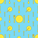 Seamless pattern with yellow plate, fork, knife and spoon in different variations on blue background Royalty Free Stock Photos