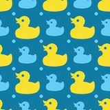 Seamless pattern with yellow rubber ducks on a blue background royalty free illustration