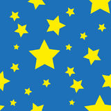 Seamless pattern from yellow stars on blue Stock Photos
