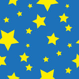 Seamless pattern from yellow stars on blue Stock Photography