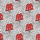 Seamless pattern with zentangle amanita mushrooms. Vector triangle background texture. Stock Image
