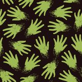 Seamless pattern of zombie hands Stock Photos