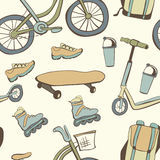 Seamless patterns with bikes, skates and other sport equipment Stock Images