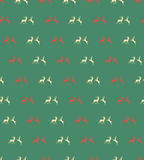 Seamless patterns with Christmas reindeers on brown background Stock Image
