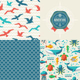 Seamless patterns of marine symbols and label in Royalty Free Stock Images