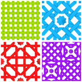 Seamless patterns set with colored crossed ribbons. Colorful crossed ribbons ornaments set. Geometric seamless patterns with crossed strips. Abstract backgrounds Royalty Free Stock Images