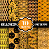 Seamless patterns set. Set of 10 elegant seamless patterns with Halloween symbols, design elements. Patterns for Halloween invitations, greeting cards Royalty Free Stock Images