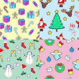 Seamless patterns set in flat style. Xmas elements. Gifft boxes, candies, angel, wreath, bell tree santa clause, snowman, socks, speech bubble, mistletoe Stock Images