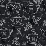 Seamless patterns with tea set, cup, teapot, leafs, flower and text on chalkboard. Background with tea set. Ideal for printing ont. O fabric and paper or scrap stock illustration