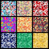 Seamless patterns from triangles. Set of different color solutions. Stock Images