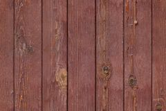 Seamless photo pattern of red wooden planks fence. Abstract seamless texture for designers with lumber panel from red decks. Beaded of thus on surface. May using royalty free stock image