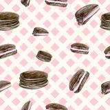 Seamless pink background with chocolate chip cookies. Stock Image