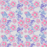 Seamless pink flowers pattern on grey dotted Royalty Free Stock Images
