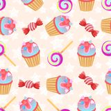 Seamless pink pattern Little delicious cupcake and candy.  Stock Photo