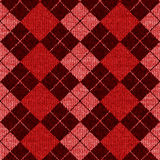 Seamless Plaid Argyle. Illustration of realistic wool argyle plaid in colors of red, pink and burgundy. Can be tiled seamlessly Royalty Free Stock Images
