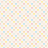 Seamless polka dot colorful pattern with hearts. Royalty Free Stock Photography