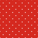 Seamless polka dot red pattern with hearts Stock Image