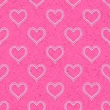 Seamless with polka dotted hearts Stock Images