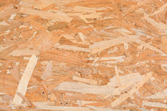 Seamless pressed wooden panel or strand board OSB background Stock Photography