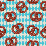 Seamless pretzel wallpaper. Salted pretzels on blue bavarian background Royalty Free Stock Photography