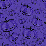 Seamless purple background with pumpkins for Halloween. Royalty Free Stock Images