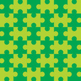 Seamless Puzzle - Green. Green puzzle background - completely seamless (You can tile this over any size and the pattern continues infinitely) EPS file also Royalty Free Stock Images
