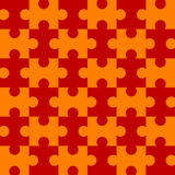 Seamless Puzzle - Red. Red and orange puzzle background - completely seamless (You can tile this over any size and the pattern continues infinitely) The EPS Royalty Free Stock Photos