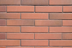 Seamless röd tegelstenväggbakgrund Arkivbild