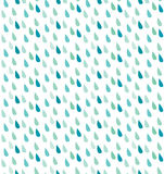 Seamless rain pattern. Seamless illustrated pattern made of rain drops in turquoise and blue Stock Image