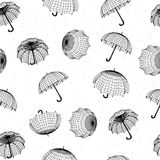 Seamless rainy pattern with umbrellas and raindrops Royalty Free Stock Image