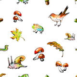 The seamless raster pattern with forest animals and leaves. The raster seamless pattern with autumn forest elements Stock Photos