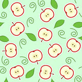 Seamless red apple cut. Seamless pattern with red apple halves and leaves Royalty Free Stock Photo