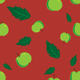Seamless red background with green apple leaves Royalty Free Stock Photography