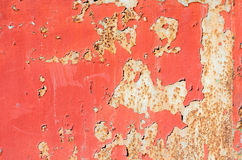 Seamless red cracked paint grunge on iron background. Royalty Free Stock Photography