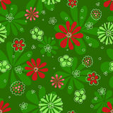 Seamless red flowerson green pattern. Vector background Royalty Free Stock Images