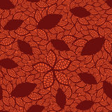 Seamless red leaves pattern on orange background Stock Photos