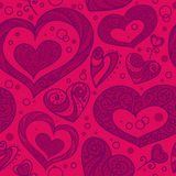Seamless red pattern with hearts. Stock Photos